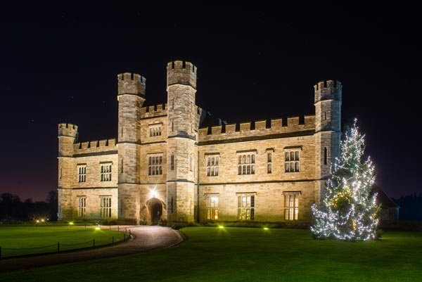 Leeds Castle and Christmas tree at night, Maidstone, Kent, England, December