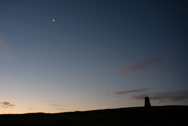 Mam Tor's trig point and crescent moon