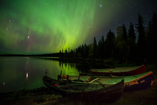 Canoes and northern lights The image was made on the first night of the Northern Lights and Autumn Colours of Lapland photo-tour that I lead every year with photographer and guide, Antti Pietikäinen. It was the most incredible display that I have, personally, witnessed that lasted for close on 3 hours with curtains of green and violet moving and swirling in the night sky. As a result, it gave us the opportunity to move to different locations and shoot a variety of compositions. After a long day of travelling and shooting through the night, everyone went to bed exhausted but exhilarated. The best feeling a photographer can have – I think! This image went on to win The Telegraph's Travel – The Big Picture photography competition. Nikon D600, 20mm f2.8, iso 3200, 20 secs. F2.8.